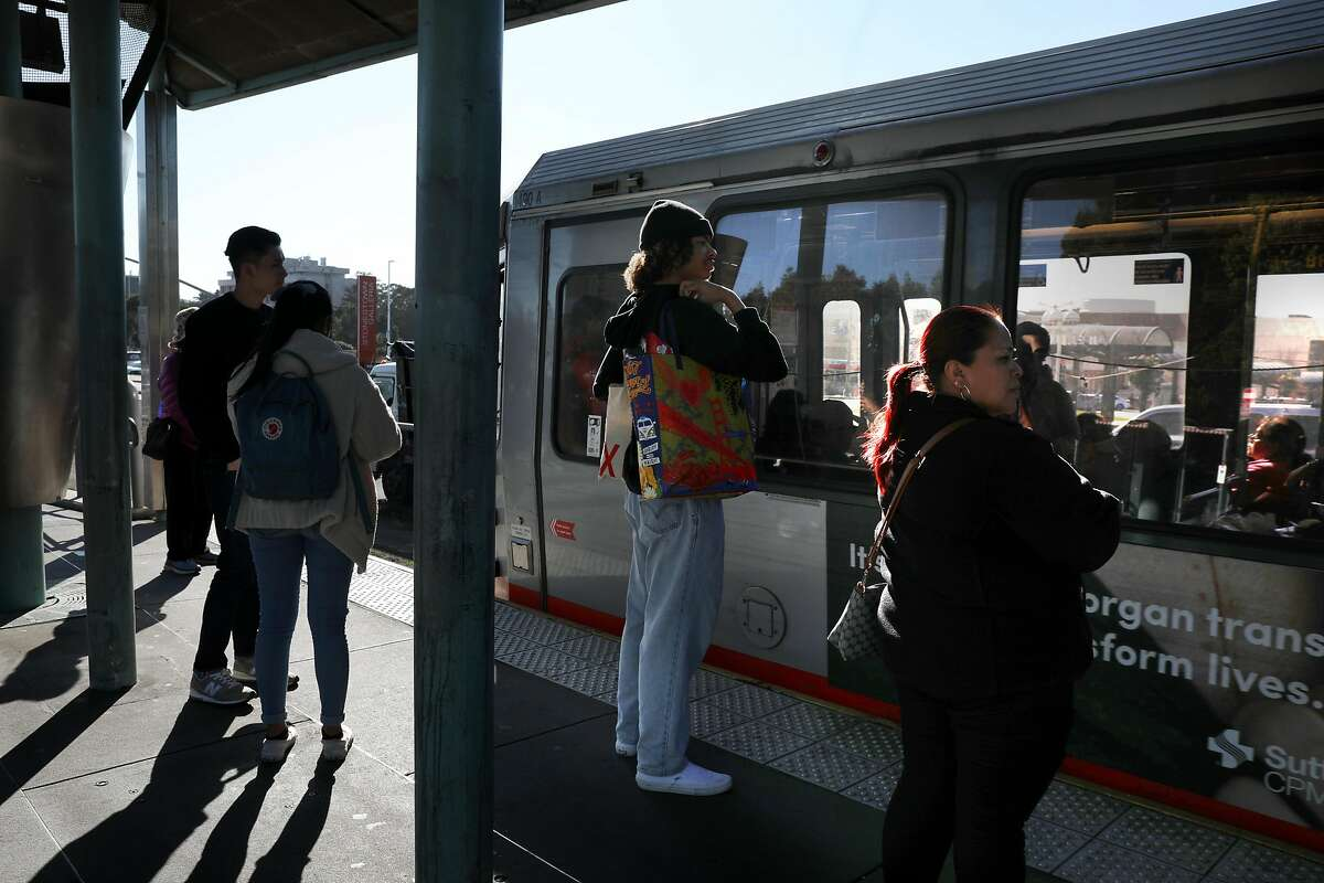 View of commuters waiting at the Muni stop on 19th Ave. at Winston Dr. on Tuesday, Feb. 18, 2020, in San Francisco, Calif.. Muni is weighing whether to raise fares by a quarter next year to $3.25, up from $3.