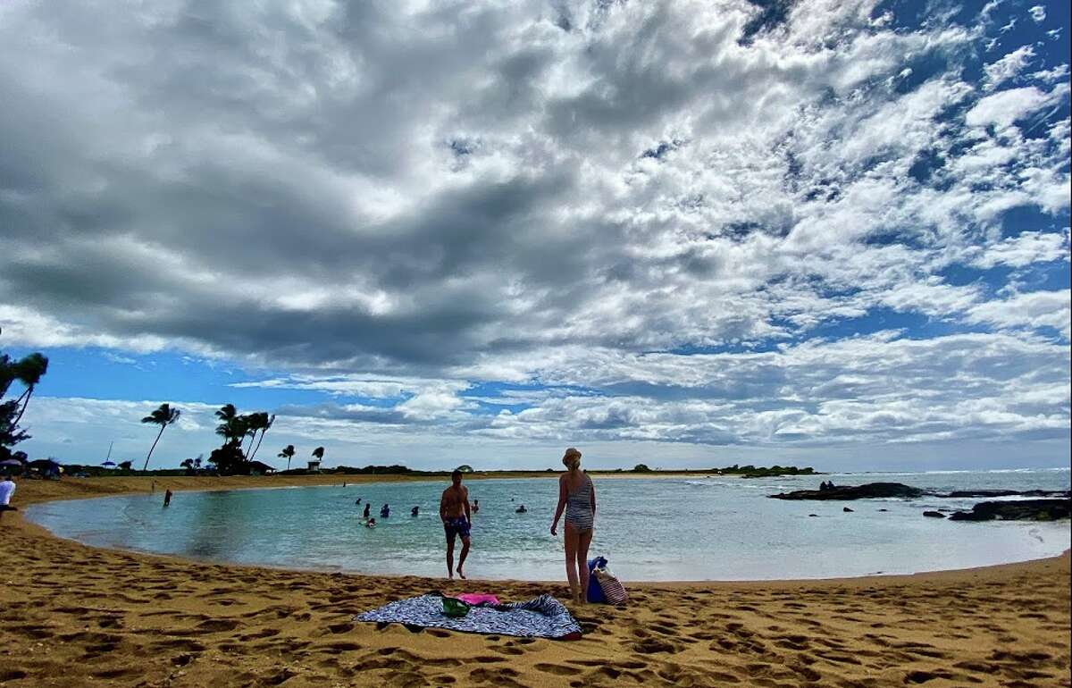 As the 14-day quarantine is lifted in Hawaii for those willing to be tested, fares fall. Pictured: Salt Pond Park in Kauai