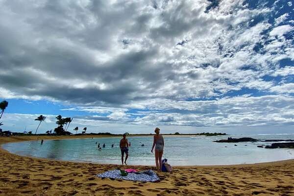 Spring break in Hawaii: Cheap to fly there, but expensive to stay, eat or play there. Pictured: Salt Pond Park in Kauai