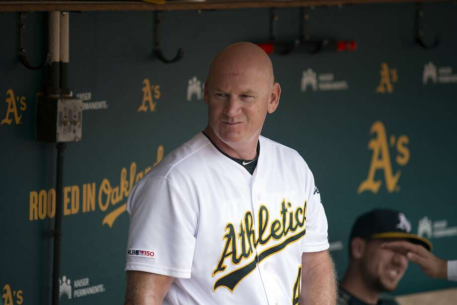 """FILE - In this Sept. 22, 2019, file photo, Oakland Athletics third base coach Matt Williams is shown in the dugout before a baseball game against the Texas Rangers in Oakland, Calif. Back managing a team, just being able to talk with his players is a challenge for Matt Williams. About 10 miles from the spring training camps of the Boston Red Sox and Minnesota Twins, the 54-year-old is at spring training with South Korea's Kia Tigers. """"You never know whether you're going to get another chance to manager or not, so I look at it as a challenge or an opportunity,'' he said, sitting in some small metal bleachers. """"So far it's been a lot of fun."""" (AP Photo/D. Ross Cameron, File) Photo: D. Ross Cameron / Associated Press"""