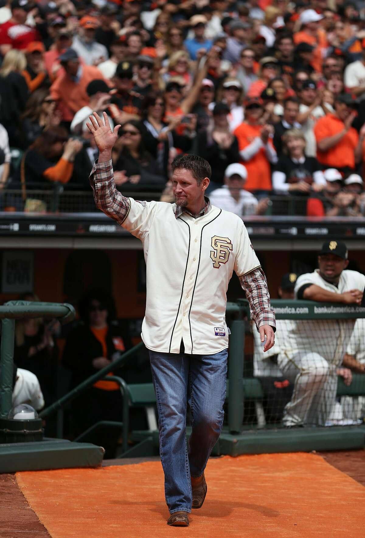 Former player Aubrey Huff of the San Francisco Giants waves to the crowd as he walks on to the field to receive his 2012 Championship Ring during the pre-game ceremony honoring the 2012 World Series champions before their game against the St. Louis Cardinals at AT&T Park on April 7, 2013 in San Francisco, California.