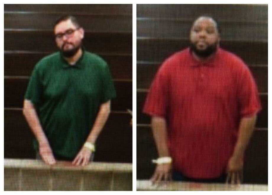 James Bradley, left, and Raymon Williams stand before a court magistrate Monday following their arrests on a charge of child indecency. Houston ISD police said elementary-age girls accused Bradley and Williams of inappropriately touching them while working as teachers in the district. Photo: Houston Chronicle / Courtesy OnScene TV