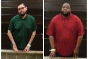 James Bradley, left, and Raymon Williams stand before a court magistrate Monday following their arrests on a charge of child indecency. Houston ISD police said elementary-age girls accused Bradley and Williams of inappropriately touching them while working as teachers in the district.