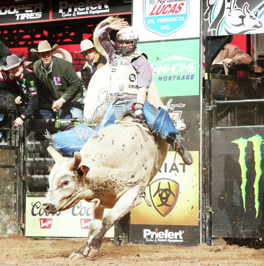 Brady Sims, originally from St. Louis, attempts to ride Con-Air, one of Martinez Bucking Bulls LLC, during the first round of the Oklahoma City Unleash the Beast Professional Bull Riders (PBR). Photo: Photo Credit Andy Watson|For The Telegraph