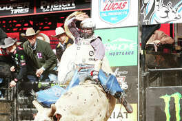 Brady Sims, originally from St. Louis, attempts to ride Con-Air, one of Martinez Bucking Bulls LLC, during the first round of the Oklahoma City Unleash the Beast Professional Bull Riders (PBR).