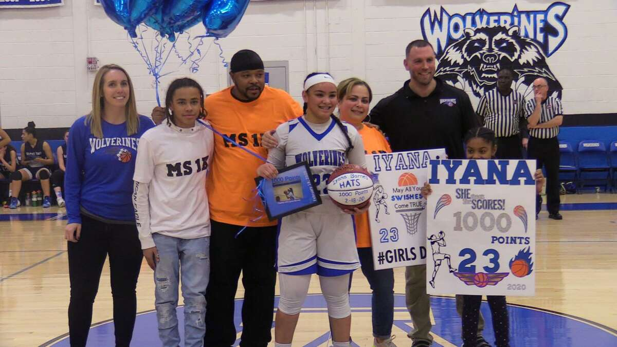 Abbott Tech's Iyana Barnes celebrates after scoring her 1,000th career point in a 45-33 win over Wolcott Tech on Tuesday in Danbury.