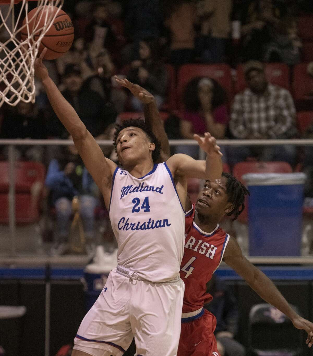 Midland Christian's Joseph Venzant goes in for a layup as Dallas Parish's Vinnie Gaddis tries to defend 02/18/2020 in the TAPPS 6A playoff at the McGraw Event Center. Tim Fischer/Reporter-Telegram