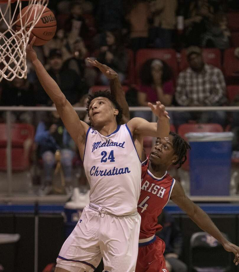 Midland Christian's Joseph Venzant goes in for a layup as Dallas Parish's Vinnie Gaddis tries to defend 02/18/2020 in the TAPPS 6A playoff at the McGraw Event Center. Tim Fischer/Reporter-Telegram Photo: Tim Fischer/Midland Reporter-Telegram