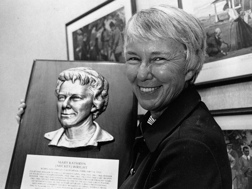 FILE - This Sept. 8, 1976 file photo shows Mickey Wright holding a World Golf Hall of Fame plaque bearing her likeness in Pinehurst, N.C., where she was inducted into the Hall of Fame. Wright can appreciate Inbee Park's pursuit of a fourth straight major this year at the Women's British Open. She just can't relate to all the attention over a potential Grand Slam. (AP Photo/File) ORG XMIT: NY184