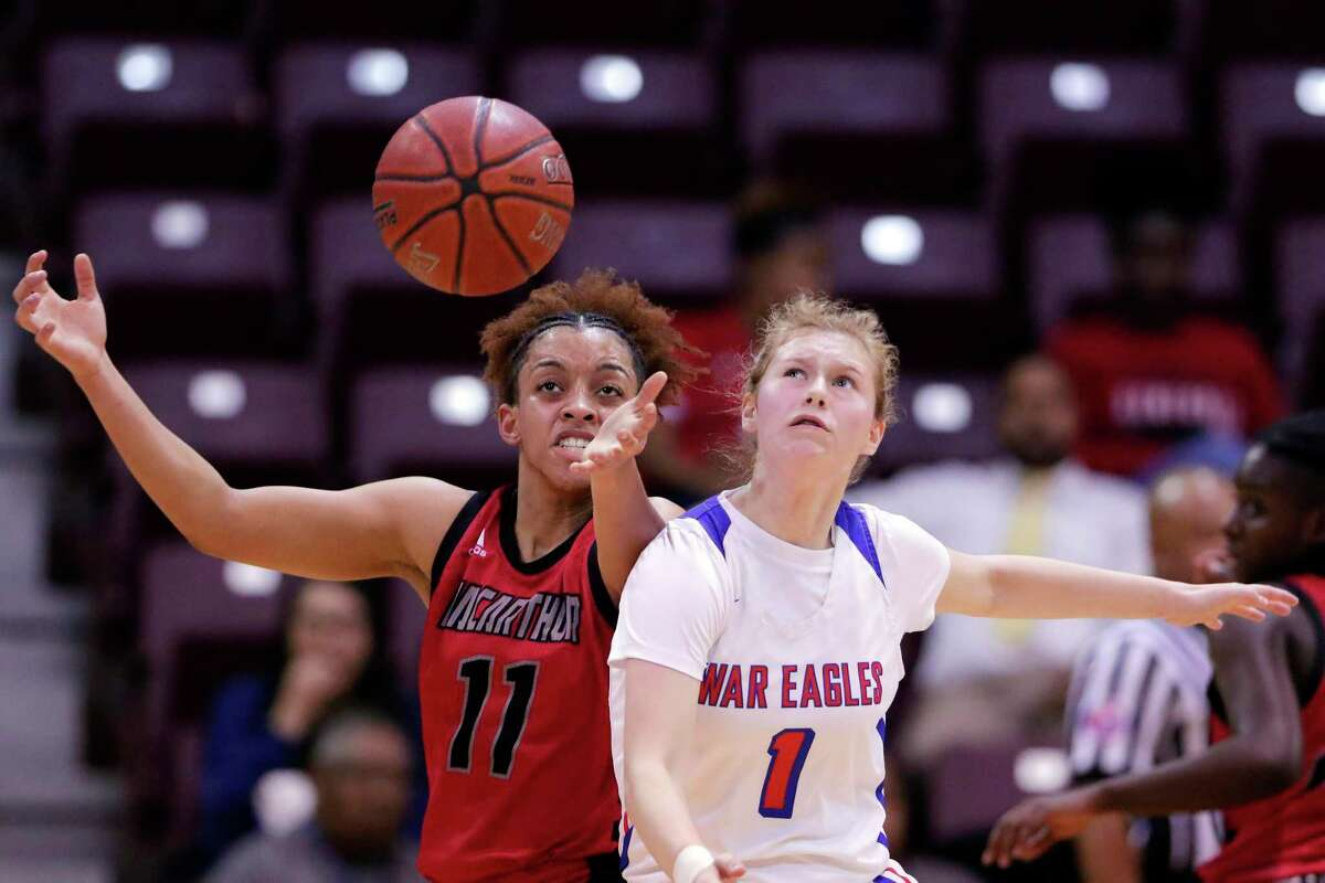 MacArthur guard Jada Stewart (11) has the ball knocked away by Oak Ridge guard Nicole Petrakovitz (1) during the first half of a Region II-6A bi-district playoff game at the Campbell Center Tuesday, Feb. 18, 2020 in Houston, TX.