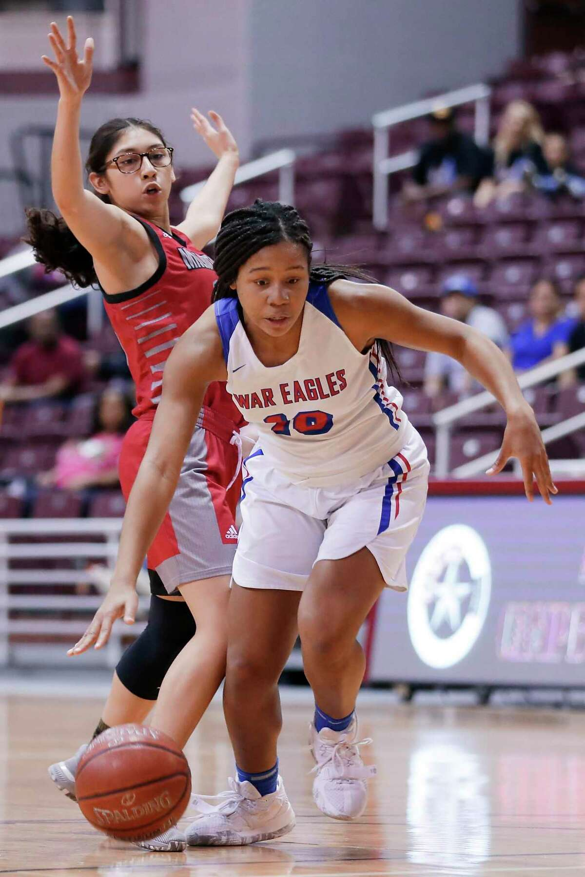 Oak Ridge forward Janiya Maxie (10) drives in front of MacArthur guard Bianca Rodriguez (15) during the first half of a Region II-6A bi-district playoff game at the Campbell Center Tuesday, Feb. 18, 2020 in Houston, TX.