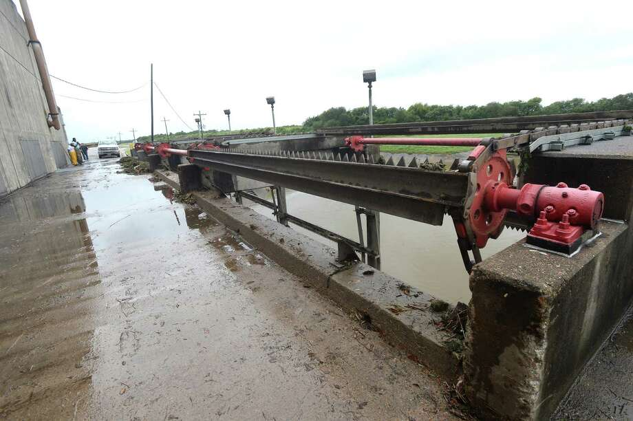 Several pumps were operating inside the Jefferson County Drainage District 7 pump station #7 on Crane Bayou in Groves, where workers regularly monitored and recorded levels to ensure the busy pumping station continues operating smoothly. Crews were on heightened alert for any drainage issues after heavy rains early Tuesday and the rapid upgrade of Imelda to tropical storm status and forecasts for continued heavy rain through the week.  Photo taken Tuesday, September 17, 2019 Kim Brent/The Enterprise Photo: Kim Brent / The Enterprise / BEN