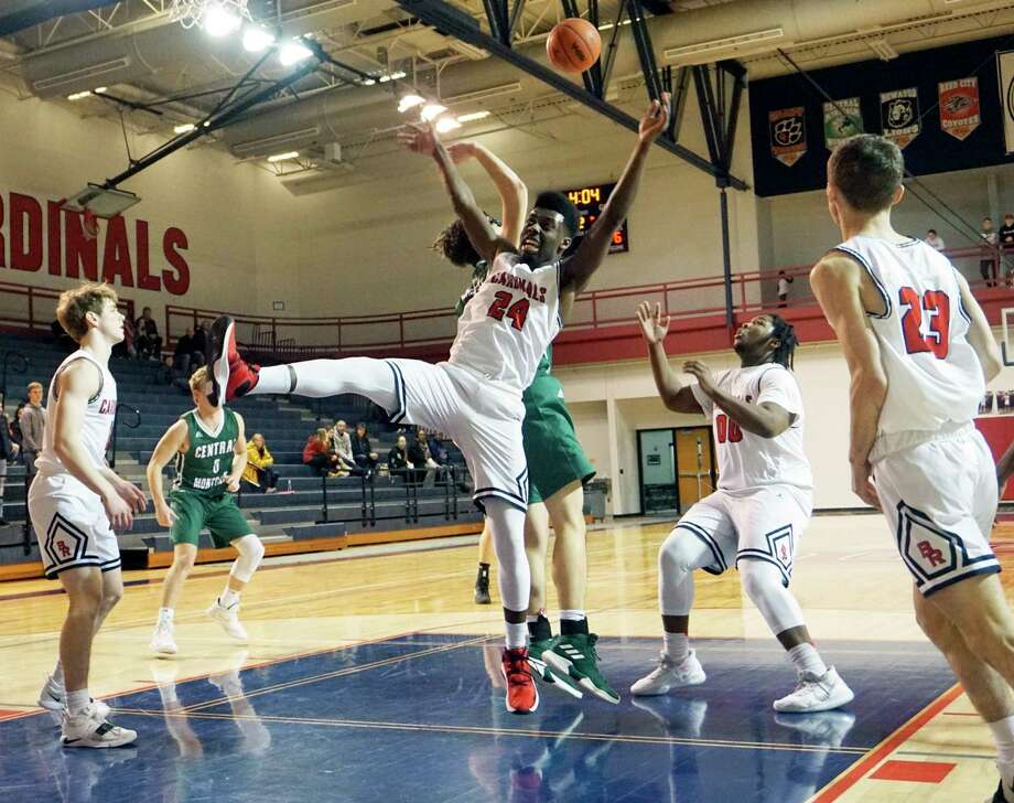 Big Rapids sophomore Jamal Strickland fights for a rebound while junior D.J. GreenBay keeps his eye on the ball during BR's home loss to Central Montcalm on Tuesday evening. (Pioneer photo/Joe Judd)