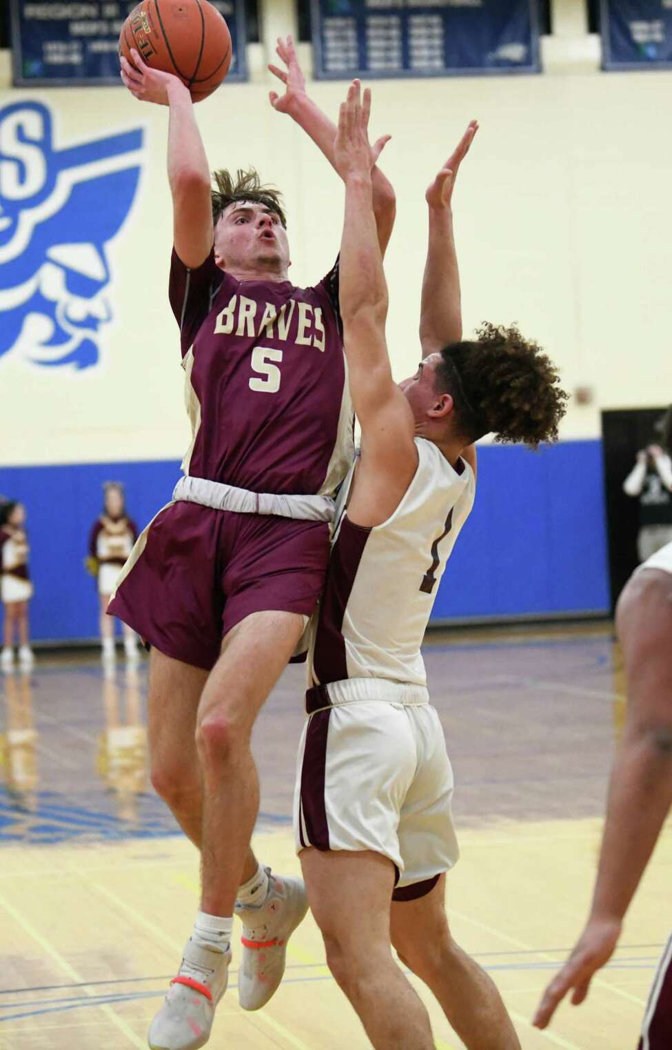 Fonda's Jackson Atty drives to the basket against Bishop Gibbons' Noah Foster during a game at Fulton Montgomery Community College on Tuesday, Feb. 18, 2020 in Johnstown, N.Y. (Lori Van Buren/Times Union)