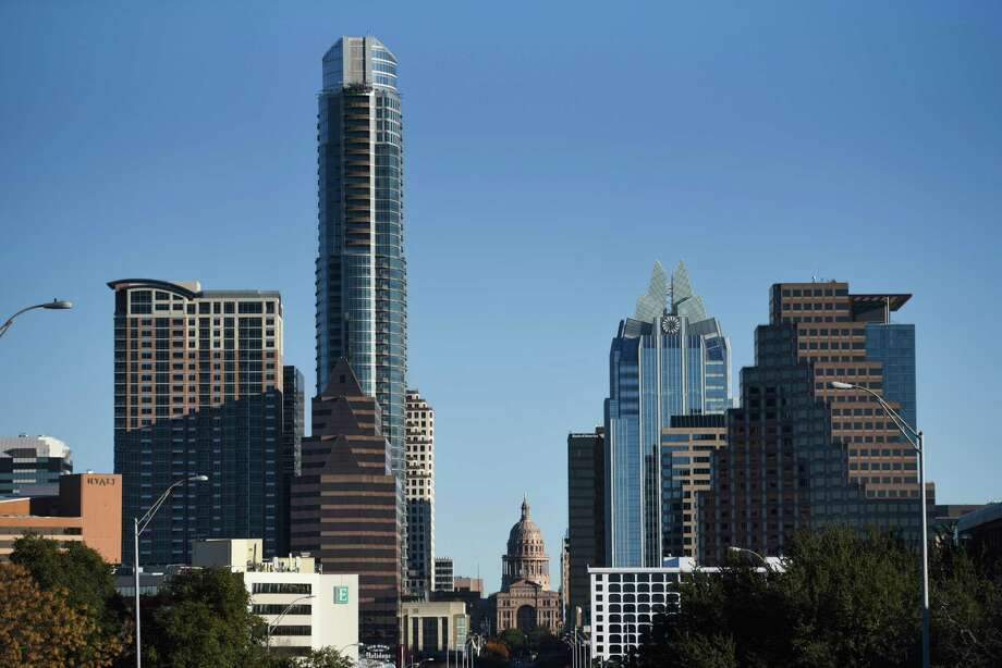 The Texas State Capitol building, center, stands in downtown Austin, Texas, U.S., on Thursday, Dec. 20, 2018. Apple Inc. announced this month it's opening new offices in Austin, investing $1 billion and bringing as many as 15,000 jobs to a city that was already the fastest growing in the nation for three years running -- with a thriving music and arts scene, an established technology industry, a rising national profile and a booming real estate market. Photographer: Callaghan O'Hare/Bloomberg Photo: Callaghan O'Hare / Bloomberg / © 2018 Bloomberg Finance LP