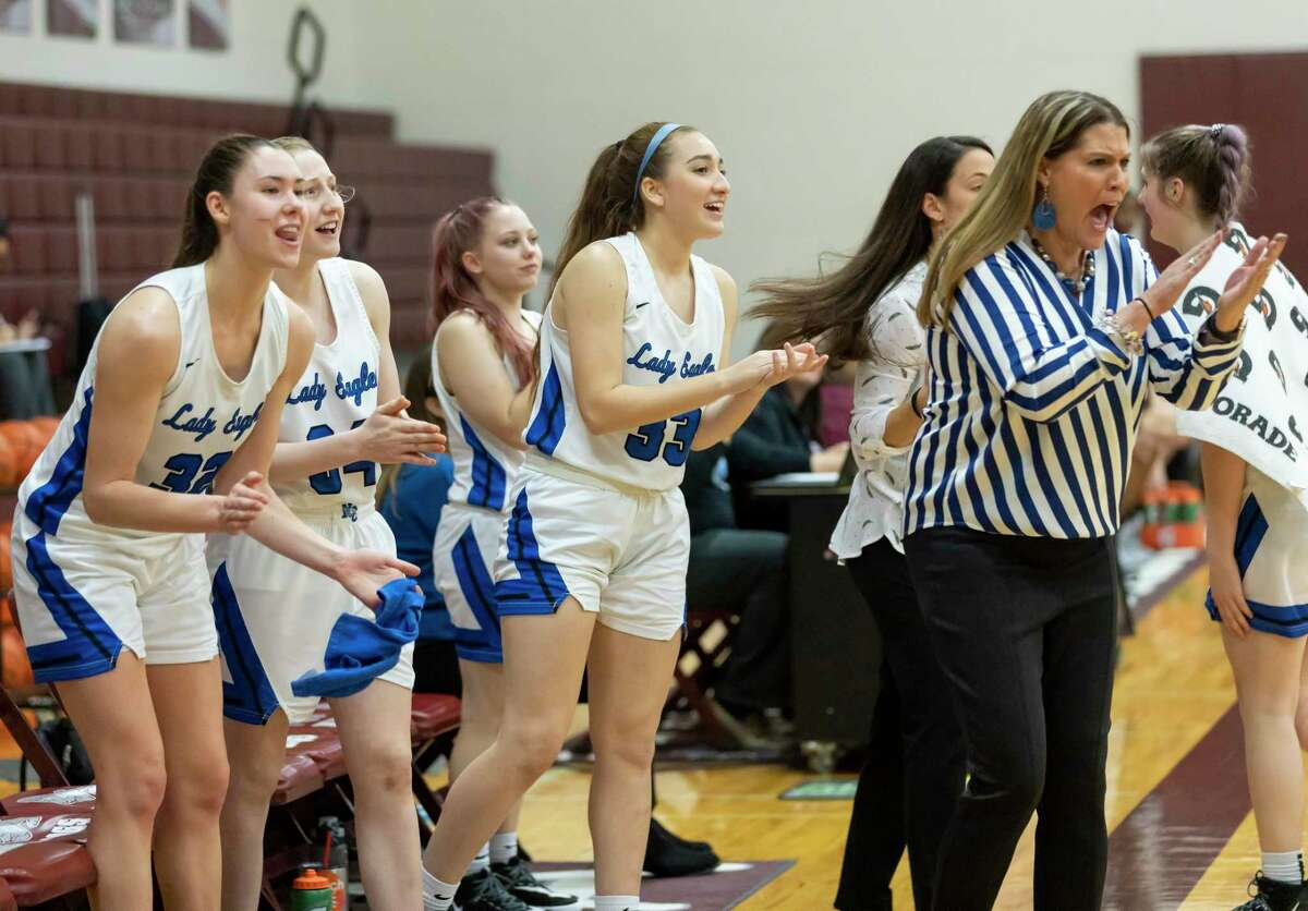 New Caney head coach Tricia Mize and players cheer as they win in a Region III-5A bi-district girls basketball playoff against A&M Consolidated at Magnolia High School in Magnolia, Tuesday, Feb. 18, 2020.