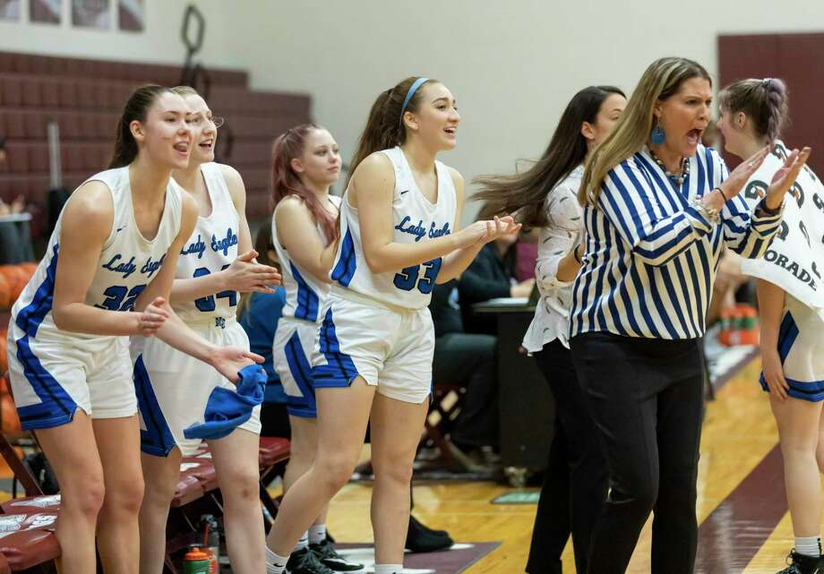New Caney head coach Tricia Mize and players cheer as they win in a Region III-5A bi-district girls basketball playoff against A&M Consolidated at Magnolia High School in Magnolia, Tuesday, Feb. 18, 2020. Photo: Gustavo Huerta, Houston Chronicle / Staff Photographer / Houston Chronicle © 2020