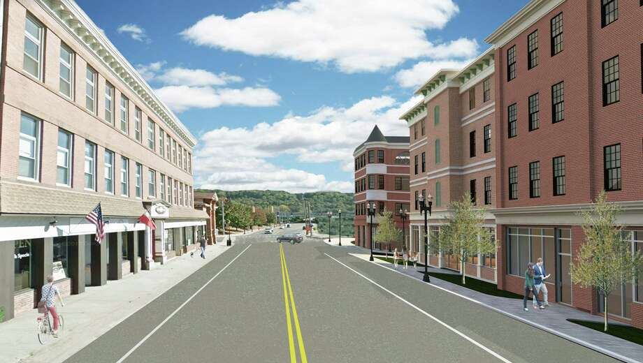 A rendering shows plans for Factory Street in Derby, facing southeast. The now-approved plan includes four-story buildings totaling 400 apartments on the upper floors and retail on the first floor. Photo: Contributed Image / Connecticut Post Contributed