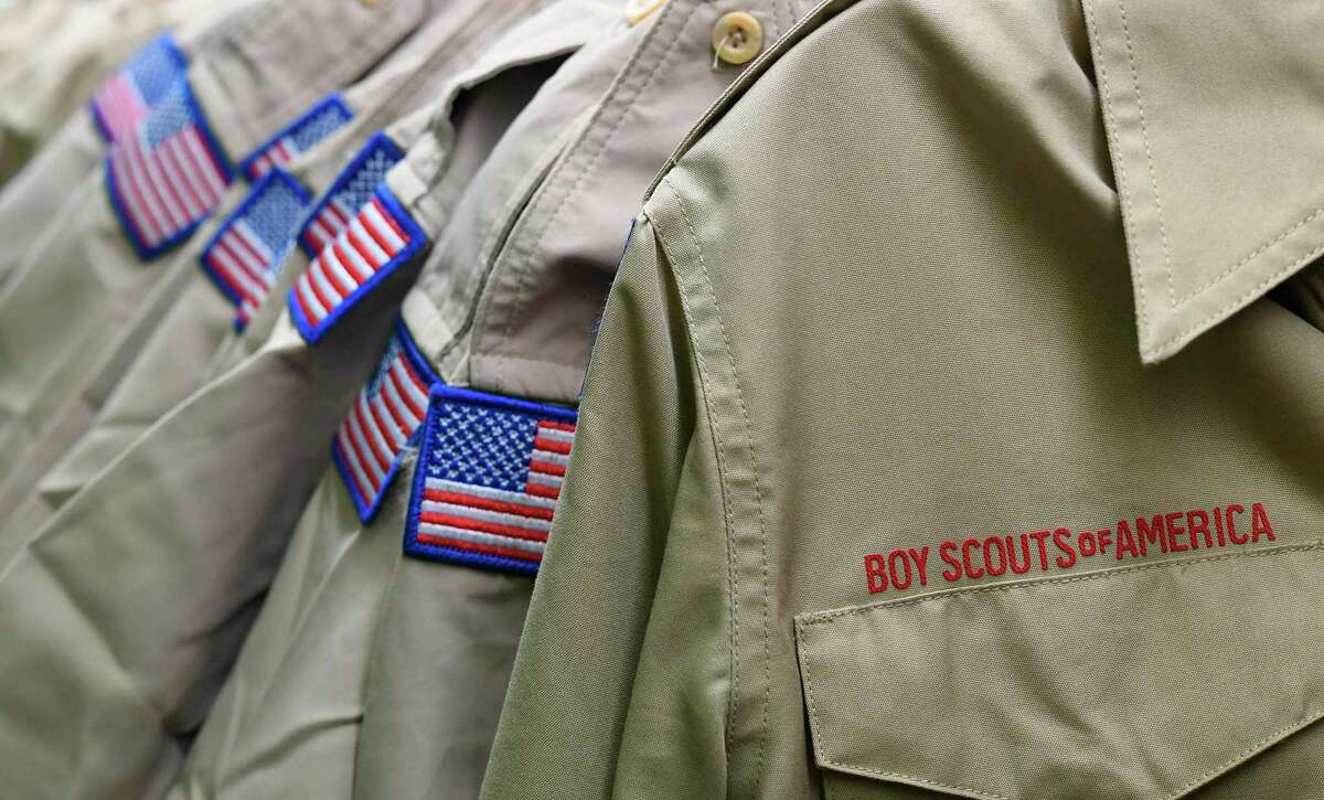 Boy Scout uniforms displayed Tuesday, Feb. 18, 2020, in the retail store at the headquarters for the French Creek Council of the Boy Scouts of America in Summit Township, Erie County, Pa. The national Boy Scouts of America urged victims to come forward Tuesday as the historic, 110-year-old organization filed for bankruptcy protection Tuesday, in the first step toward creating a huge compensation fund for potentially thousands of men who were sexually molested as youngsters decades ago by scoutmasters or other leaders. (Christopher Millette/Erie Times-News via AP)