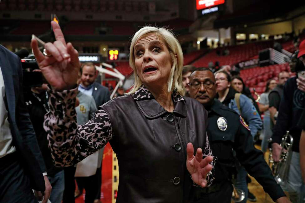 Baylor coach Kim Mulkey thanks the fans in the crowd after the team's NCAA college basketball game against Texas Tech, Tuesday, Feb. 18, 2020, in Lubbock, Texas. Mulkey won her 600th career game as Baylor defeated Texas Tech 77-62. (AP Photo/Brad Tollefson)