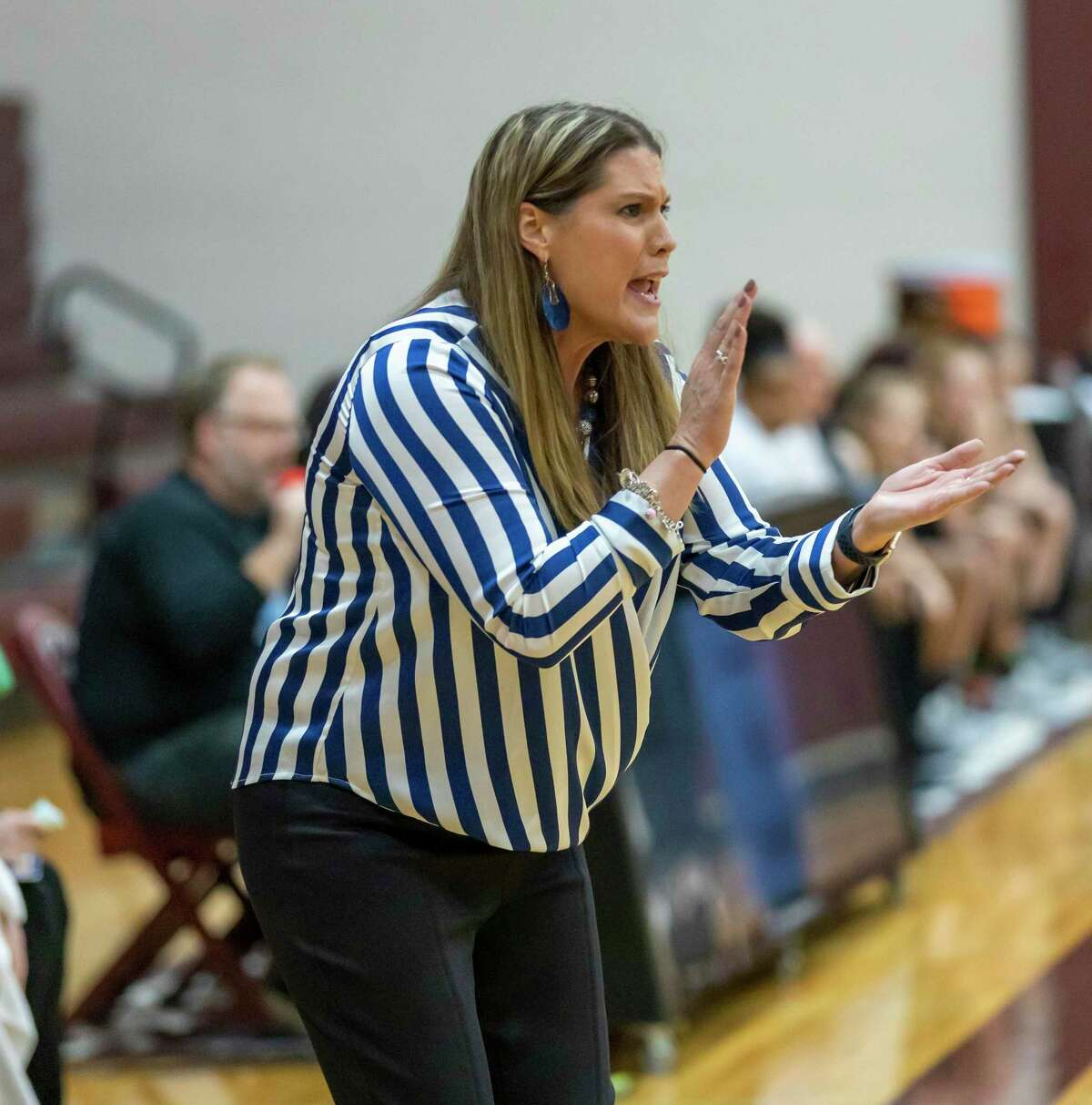 New Caney head coach Tricia Mize reacts after New Caney scores in a Region III-5A bi-district girls basketball playoff against A&M Consolidated high school during the second half at Magnolia High School in Magnolia, Tuesday, Feb. 18, 2020.