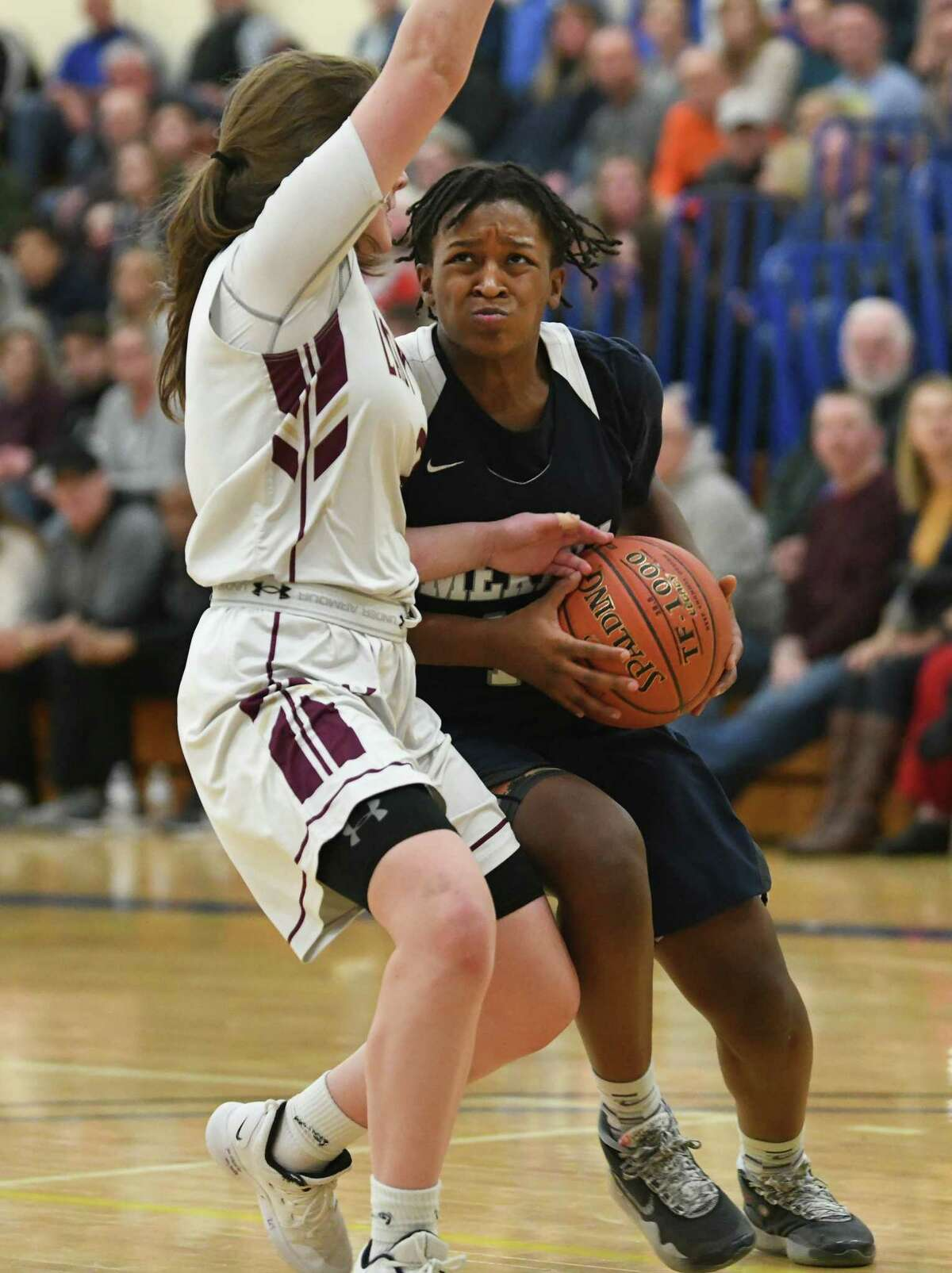 Mekeel Christian Academy's Mikyla Mitchell drives to the basket against Fonda's Carly Atty during a game at Fulton Montgomery Community College on Tuesday, Feb. 18, 2020 in Johnstown, N.Y. (Lori Van Buren/Times Union)