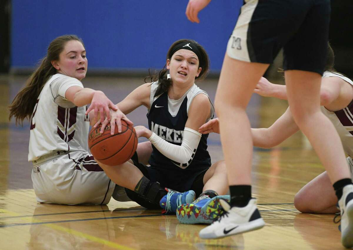 Fonda's Carly Atty, left, battles for the ball with Mekeel Christian Academy's Avery Mills during a game at Fulton Montgomery Community College on Tuesday, Feb. 18, 2020 in Johnstown, N.Y. (Lori Van Buren/Times Union)