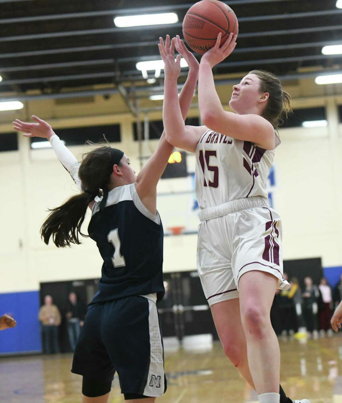 Fonda's Abigail Lombardoni drives to the basket against Mekeel Christian Academy's Avery Mills during a game at Fulton Montgomery Community College on Tuesday, Feb. 18, 2020 in Johnstown, N.Y. (Lori Van Buren/Times Union)