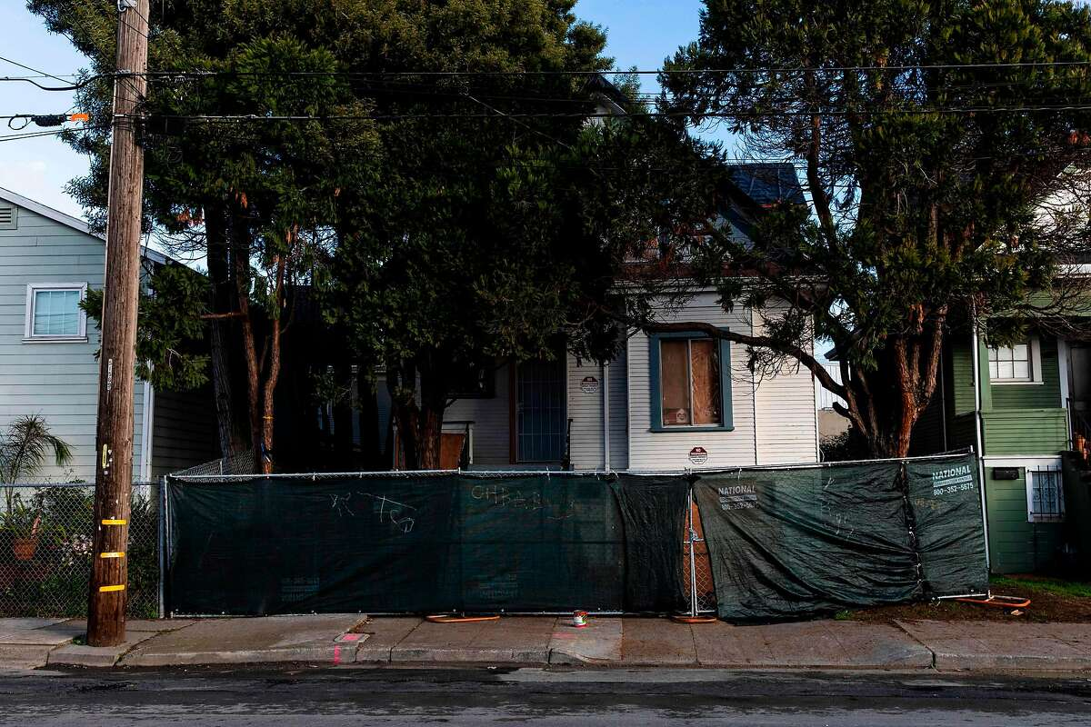 A newly-erected fence blocks the front of a vacant home that Moms 4 Housing activists occupied during a months-long protest, which ended in a court ordered eviction. (Photo by Philip Pacheco / AFP) (Photo by PHILIP PACHECO/AFP via Getty Images)