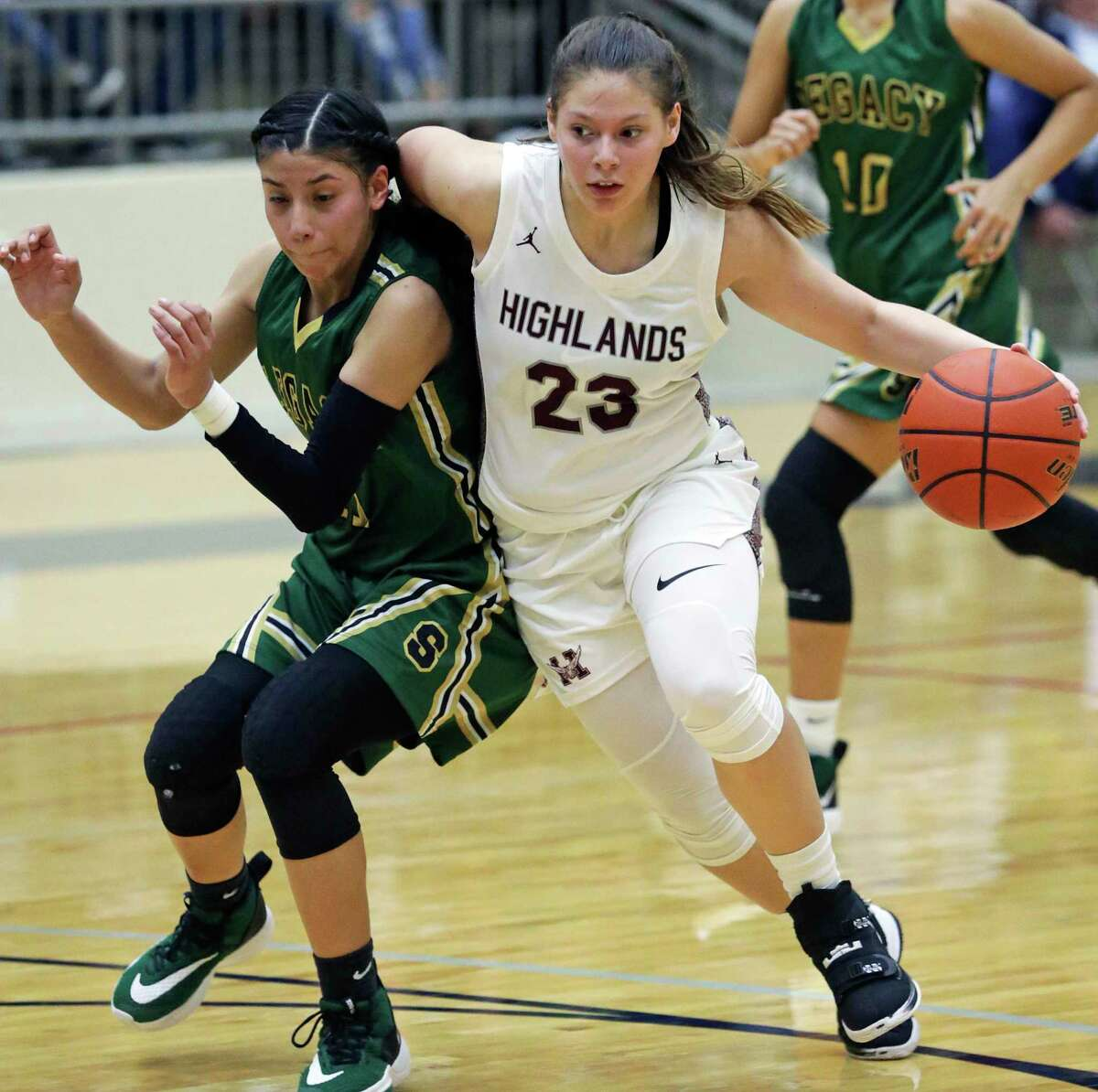 Owl guard Layla Mendoza slides past Ashley Corpus as Highlands plays Southwest Legacy in first round girls basketball playoffs at Alamo Convocation Center on Feb. 18, 2020.
