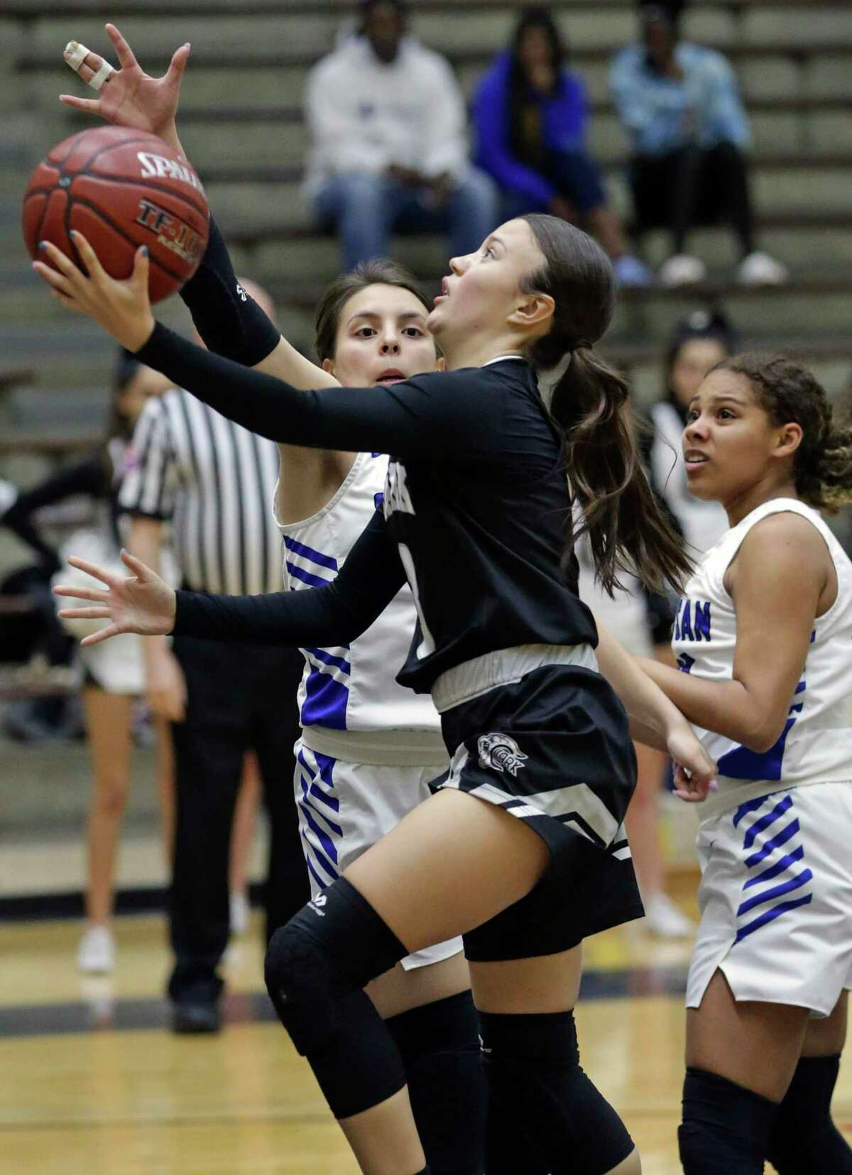 Cougar point guard Sydney Solitaire breaks through for a layup as South San plays Clark in first round girls basketball playoffs at Alamo Convocation Center on Feb. 18, 2020.