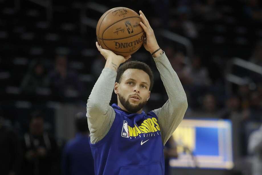 Injured Golden State Warriors guard Stephen Curry shoots before an NBA basketball game against the Miami Heat in San Francisco, Monday, Feb. 10, 2020. (AP Photo/Jeff Chiu) Photo: Jeff Chiu, Associated Press