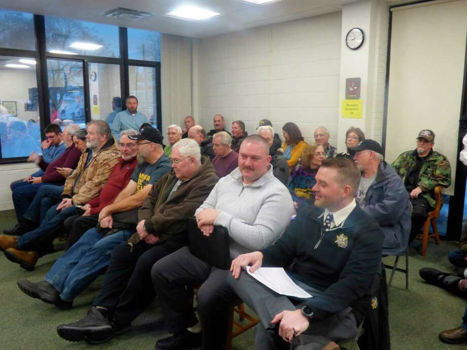 Community members fill the county boardroom to capacity during this month's meeting of the Manistee County Board of Commissioners. Residents arrived to voice their support for and opposition to a resolution aimed at declaring Manistee County a Second Amendment Sanctuary. (Scott Fraley/News Advocate)