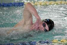 Darien's Connor Martin swims to a victory in the 500 freestyle during the Wave's swim meet against New Canaan at the Darien YMCA on Wednesday, Jan. 15, 2020.