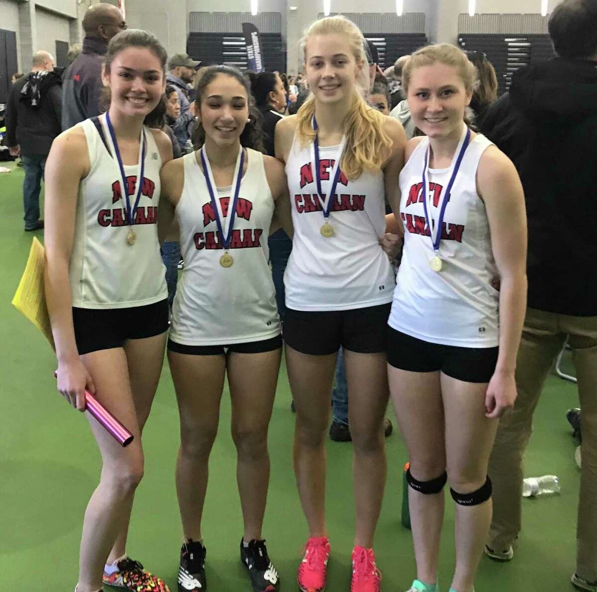 The New Canaan 4x800 relay team of, from left, Lauren Doherty, Ella Gibb, Emma Ognibene and Sophie Curcio with their medals after winning at the CIAC Class L girls track and field championships in New Haven on Saturday, Feb. 15, 2020.