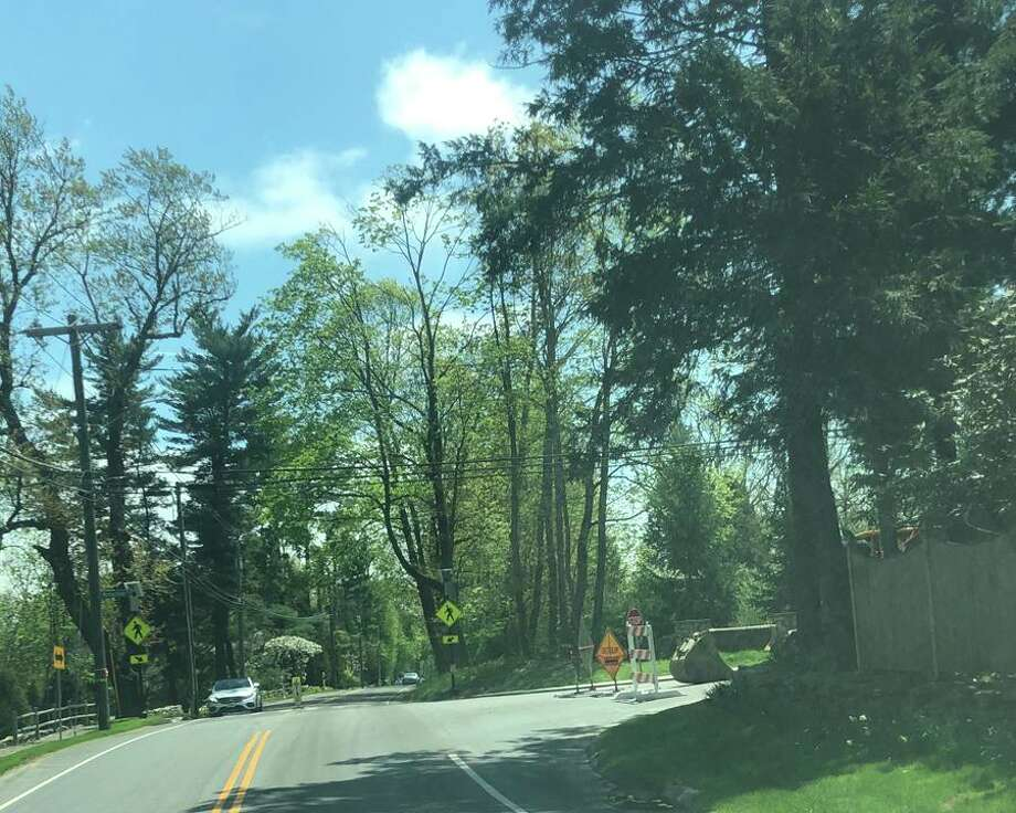 Travel on Wahackme Road between Weed Street, and Ponus Ridge Road near Irwin Park in New Canaan, Conn., is limited to local traffic on May 7, 2019, as part of water main work done by the Aquarion Water Company. Contributed photo Photo: New Canaan Advertiser