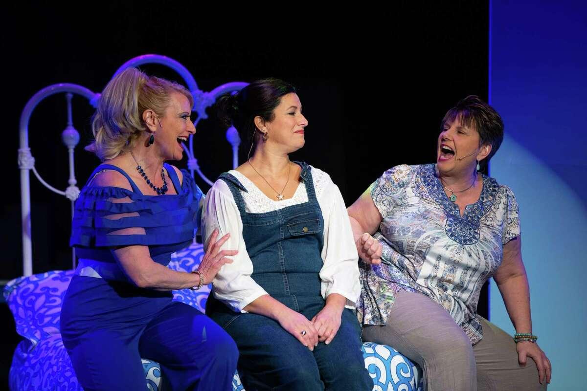 Michelle Lambert, left, Carla Sullivan, center, and Denise Smoker perform in Center Stage Theatre's production of Mamma Mia!