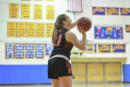 Cameron McClellan hit six 3-pointers and scored 18 points in Ridgefield's win over Fairfield Warde.