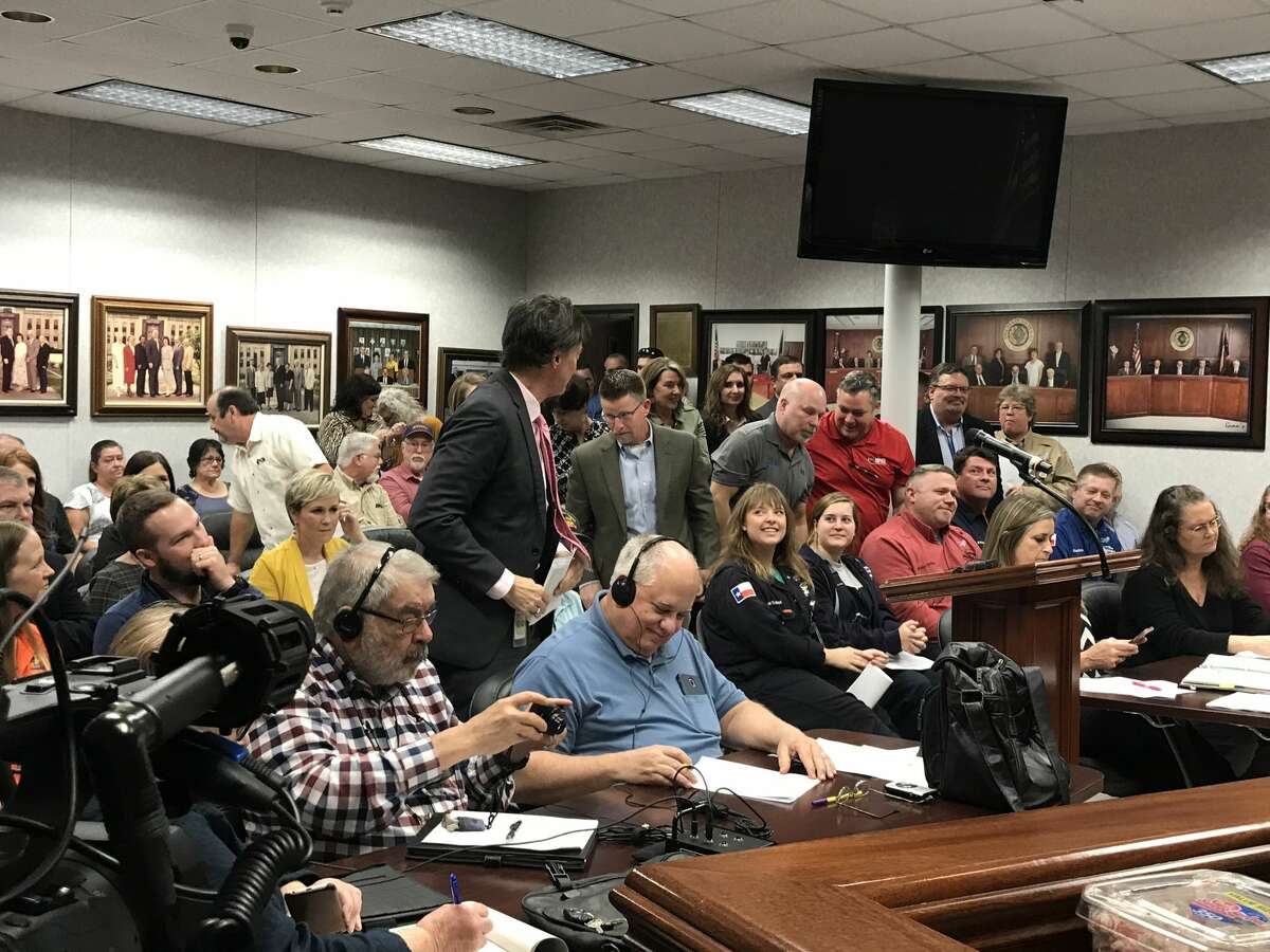 A group of residents who attended an Orange County Commissioners meeting on February 18, 2020 stood and applauded after the governing body voted unanimously to approve a 10-year, 100 percent tax abatement for a potential $5.6 billion investment from Chevron Phillips Chemical.