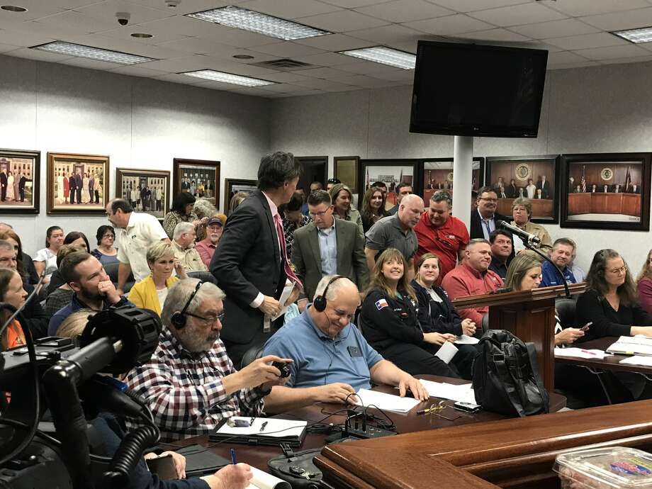 A group of residents who attended an Orange County Commissioners meeting on February 18, 2020 stood and applauded after the governing body voted unanimously to approve a 10-year, 100 percent tax abatement for a potential $5.6 billion investment from Chevron Phillips Chemical. Photo: Kaitlin Bain