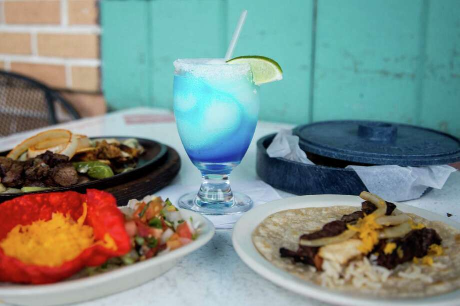 Some of Houston's oldest restaurants, such as the El Patio, a Tex-Mex icon known for its bright blue margaritas, are offering various deals and delivery options to help navigate the pitfalls of the pandemic. Photo: El Patio