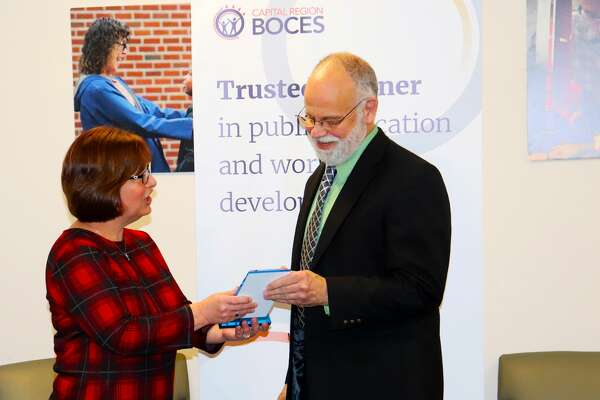Longtime Capital Region BOCES educator Bill Rouleau was honored recently for his dedication to students, BOCES and the greater community. Rouleau, a 20-year teacher who joined the ranks of BOCES after a career in the private sector, was presented with a Commitment of Excellence Award by BOCES leadership.