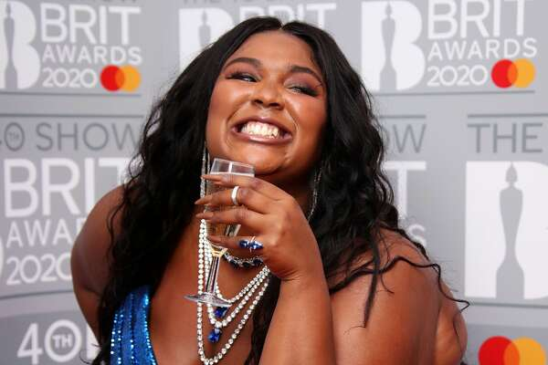 LONDON, ENGLAND - FEBRUARY 18: (EDITORIAL USE ONLY) Lizzo poses in the winners rooms at The BRIT Awards 2020 at The O2 Arena on February 18, 2020 in London, England. (Photo by Mike Marsland/WireImage)