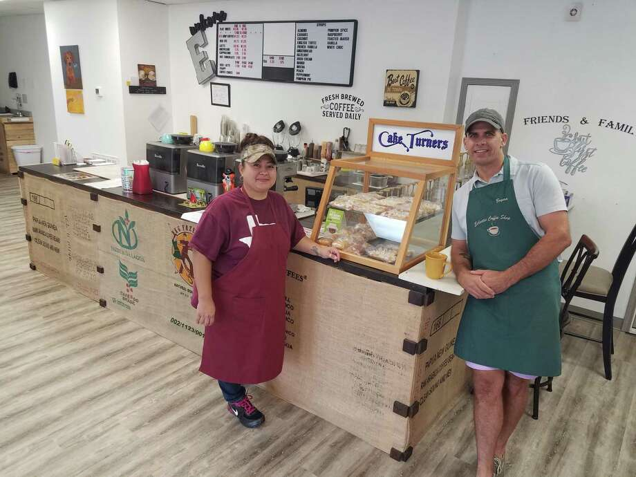 Barista Jaimie Roberts, left, and ownerBryan Denison are ready to greet customers to Eclectic Coffee Shop in Lumberton Photo: Sierra Kondos / Sierra Kondos