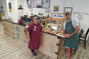 Barista Jaimie Roberts, left, and owner Bryan Denison are ready to greet customers to Eclectic Coffee Shop in Lumberton