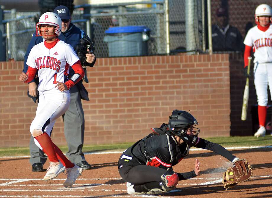 Plainview's Jenna Sepeda beats the throw home to score the first run of the season for the Lady Bulldogs during their season opener on Tuesday, Feb. 18, 2020 against Borger. Photo: Nathan Giese/Planview Herald