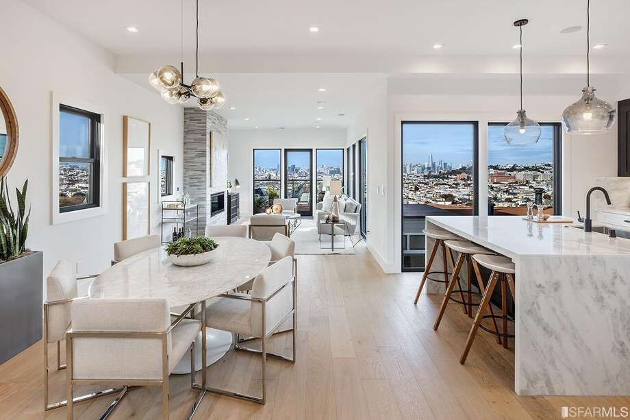 The home is located on Bernal'sNorth Slope and has 270-degree views from the main level open concept entertaining space and deck. Photo: Marcell Puzsar And Rob J. Photography For Sotheby's International Realty