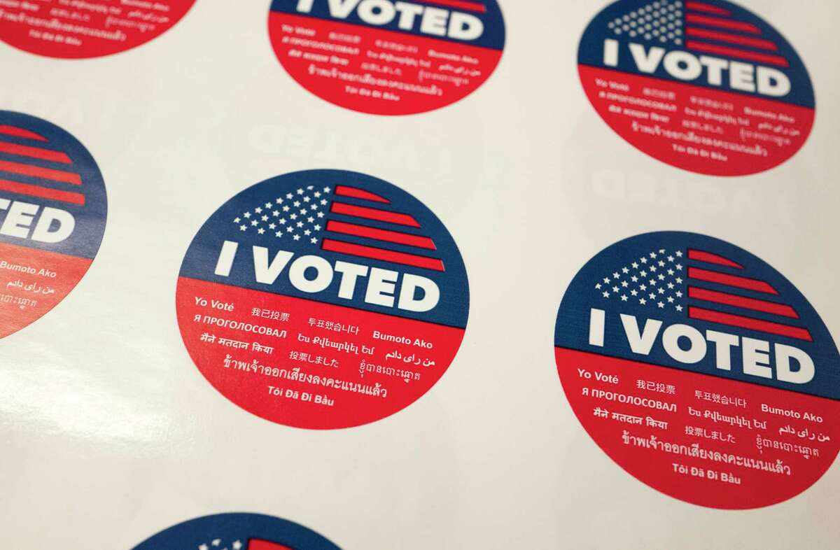 """""""I Voted"""" stickers wait for voters at a polling station."""