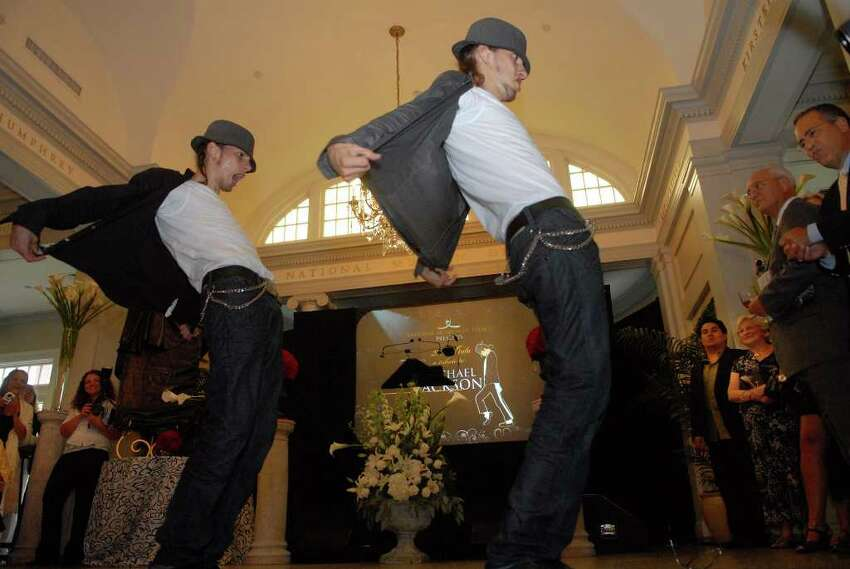 Twins Facundo Lombard, left, and Martin Lombard, known as the Lombard Twins, perform using Michael Jackson-like dance moves to a melody of Jackson's music during a ceremony to induct Michael Jackson into the Mr. & Mrs. Cornelius Vanderbilt Hall of Fame at the National Museum of Dance in Saratoga Springs on Sunday, Aug. 15, 2010. (Paul Buckowski / Times Union)