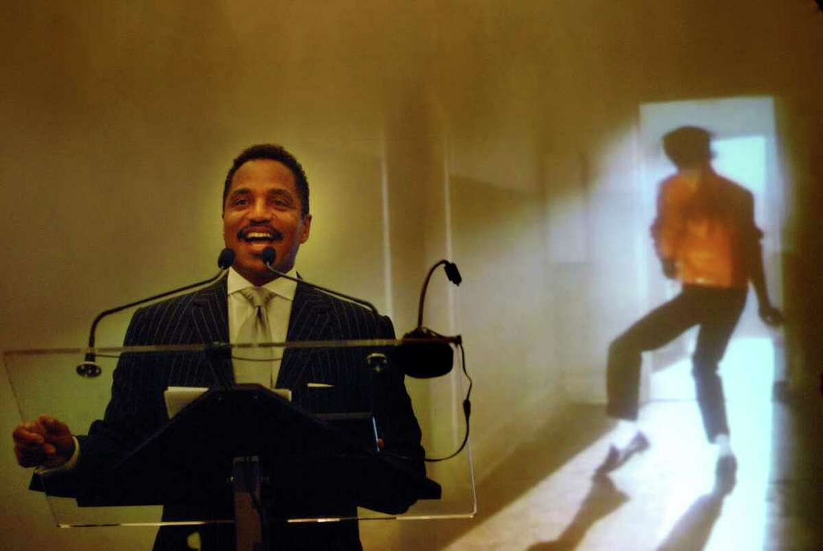 Michael Jackson's brother Marlon Jackson addresses those gathered during the ceremony to induct Michael Jackson into the Mr. & Mrs. Cornelius Vanderbilt Hall of Fame at the National Museum of Dance in Saratoga Springs on Sunday, Aug. 15, 2010. In the background, a tribute video of Michael Jackson plays on a large screen. (Paul Buckowski / Times Union)